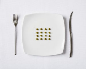 Plate with small peas conceptualizing eating